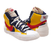 NIKE × sacai BLAZER MID VARSITY MAIZE/MIDNIGHT NAVY/WHITE/VARSITY RED BV0072-700画像